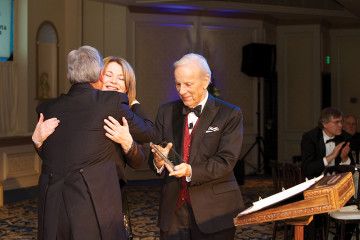 Debbie Turner and Conrad Prebys receiving an award from KPBS general manager Tom Karlo • Photo by Spark Photography