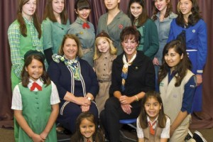 Girl Scouts S.D. board chair Katie Sullivan (seated at left) and Carol LeBeau (right) with Girl Scouts modeling vintage uniforms