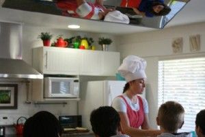 Skyline Elementary students watch as chef Amanda Curry prepares a healthy quesadilla